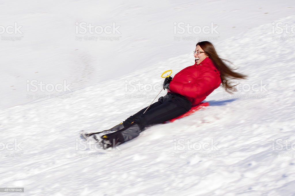 woman on sledge - Blur motion stock photo