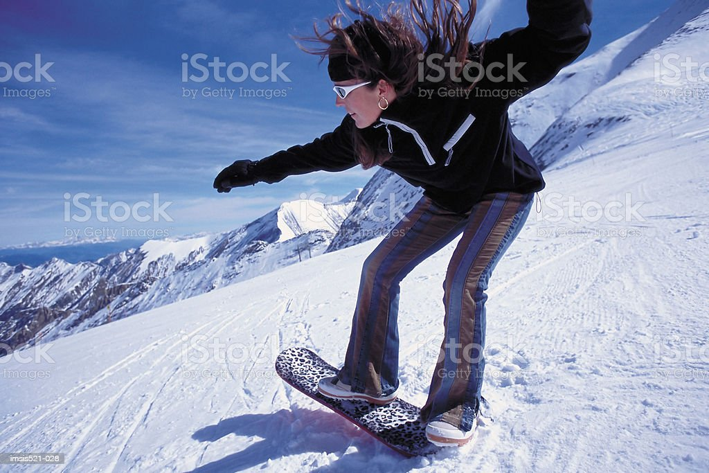 Woman on snowboard royalty free stockfoto