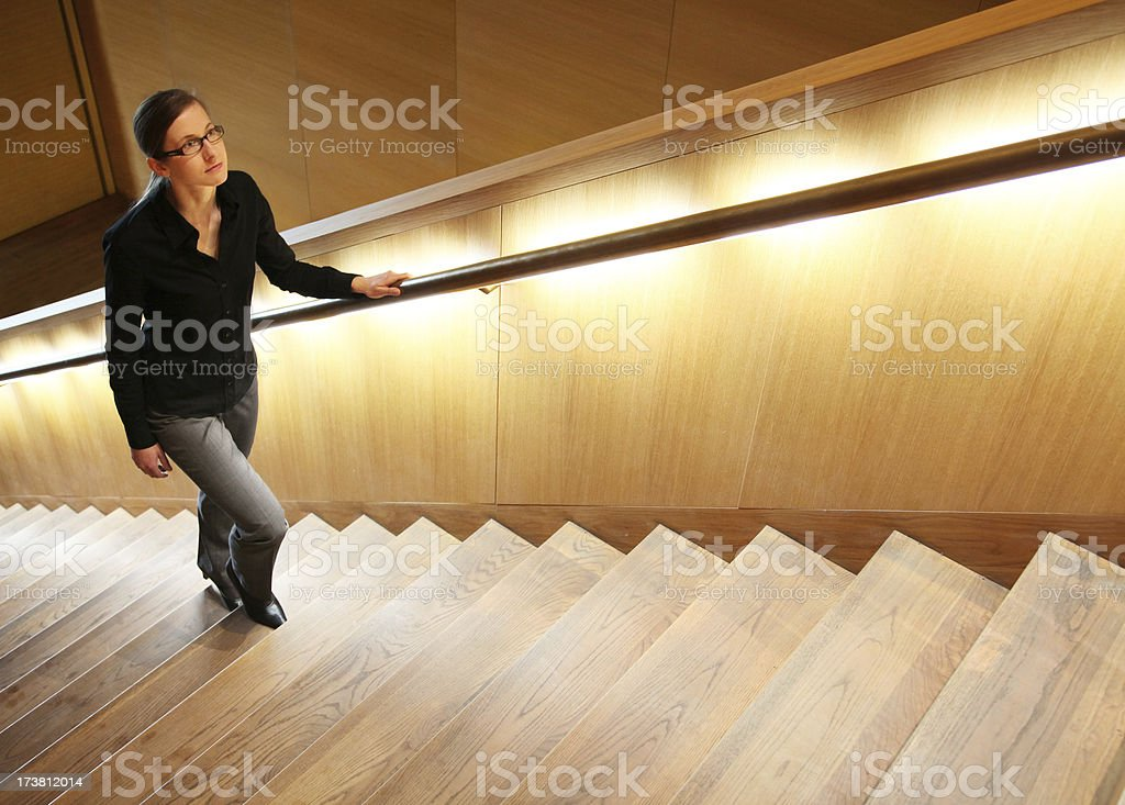 woman on staircase stock photo