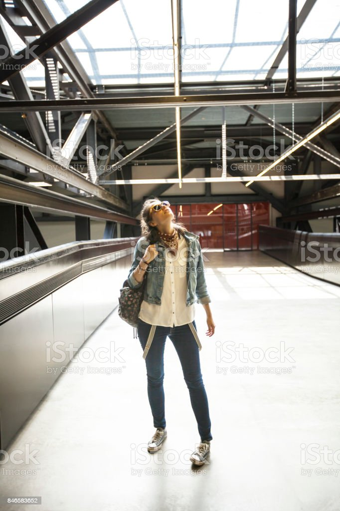 Woman on station platform looking up stock photo