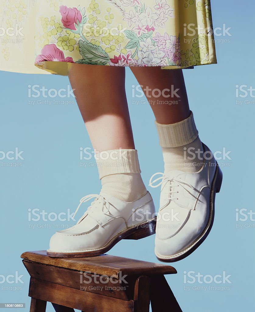 Woman on stepladder stock photo