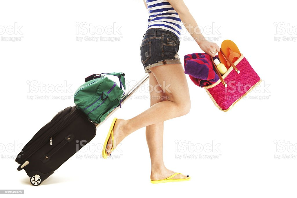 Woman on Summer Vacation Travel with Beach Bag, Suitcase, Luggage stock photo