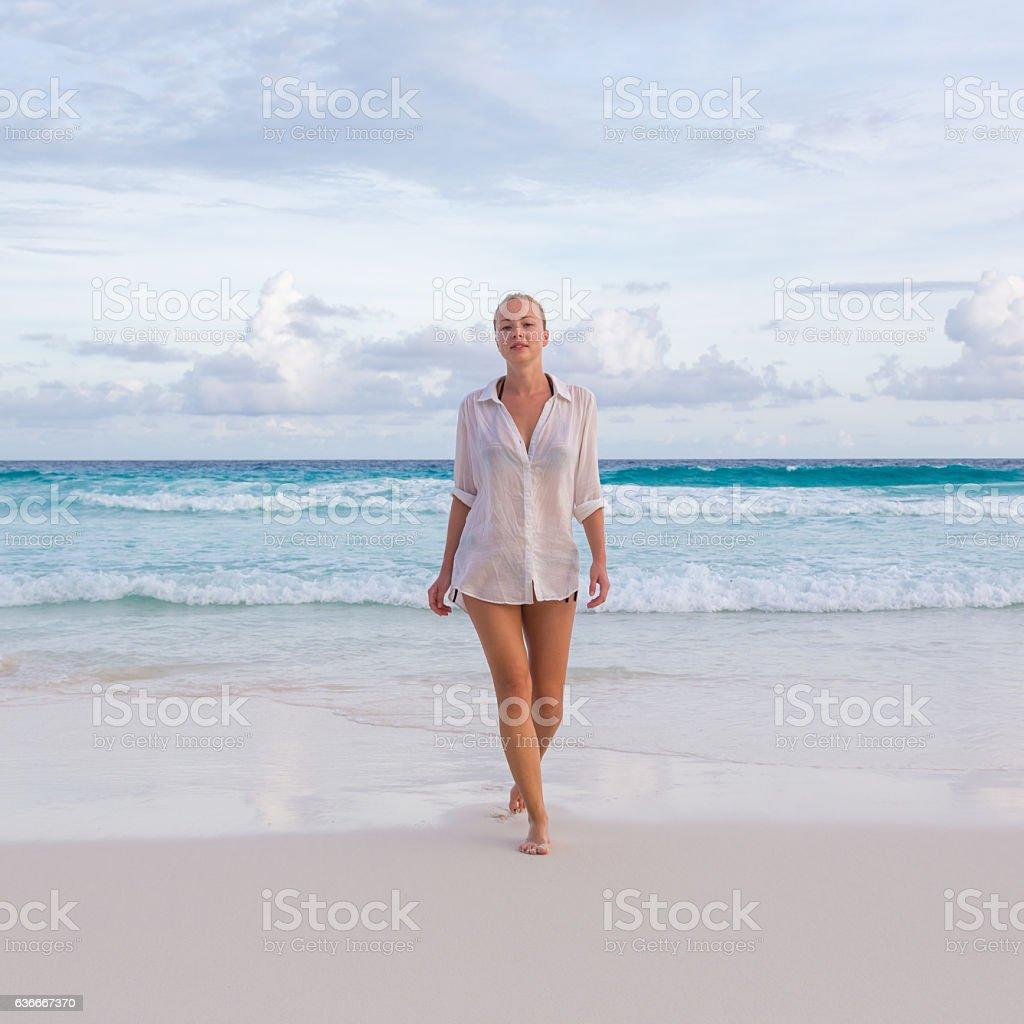Woman on summer vacations at tropical beach of Mahe Island Lizenzfreies stock-foto