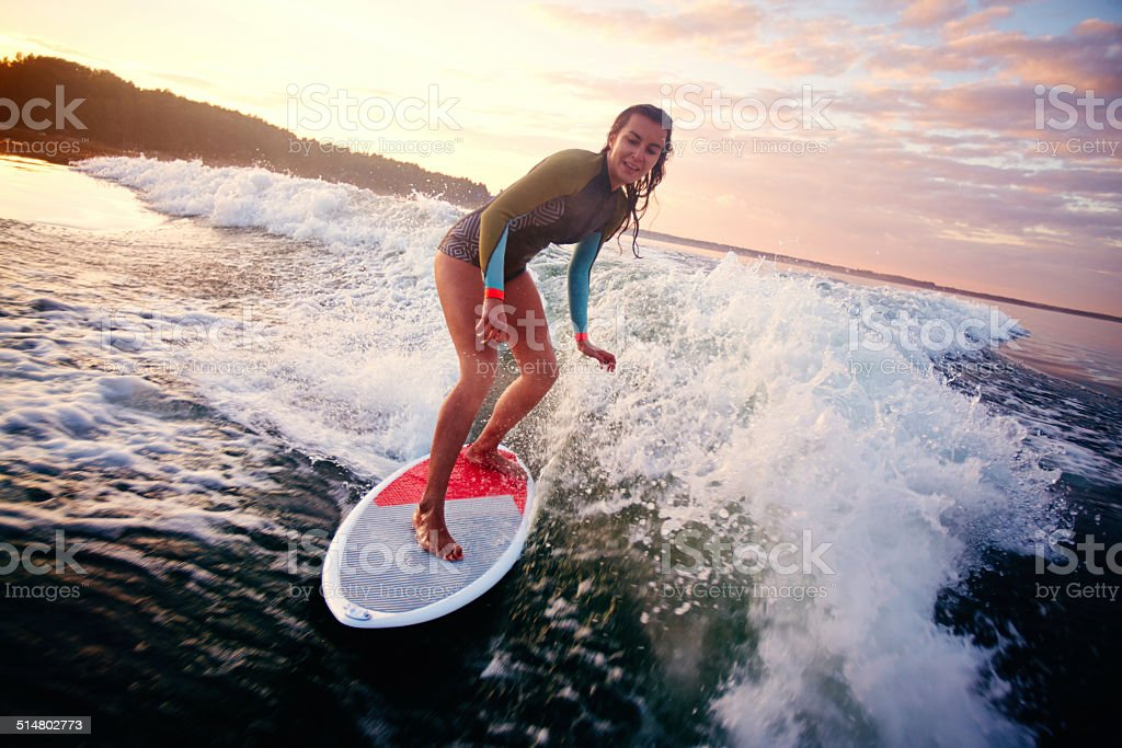 Woman on surfboard stock photo