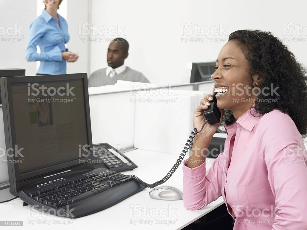 Woman on telephone in office stock photo
