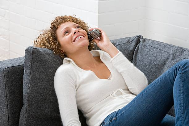 Woman on telephone  cordless phone stock pictures, royalty-free photos & images