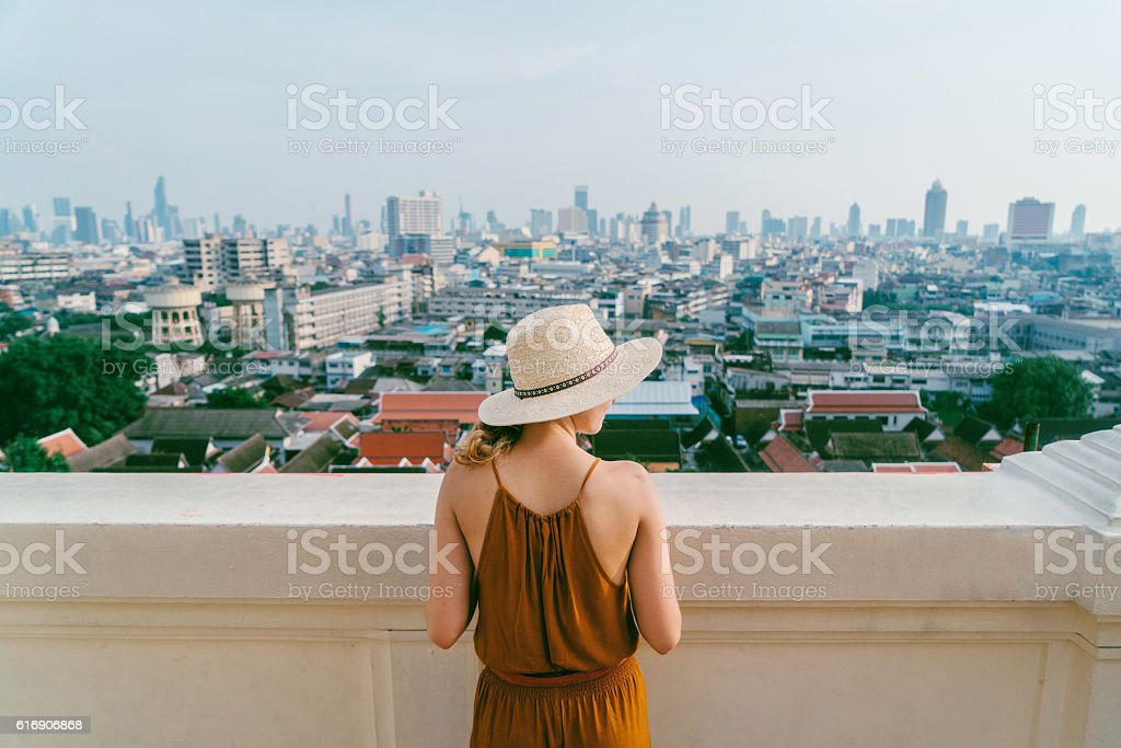 Woman on the background of Bangkok stock photo