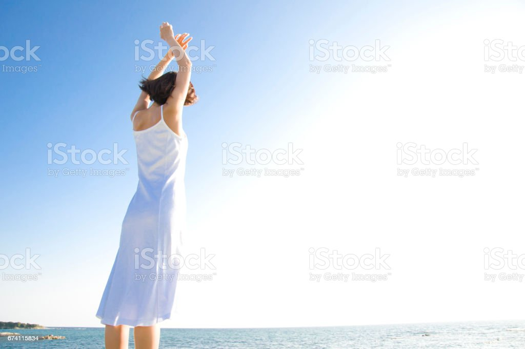 Woman on the beach to stretch his back royalty-free stock photo