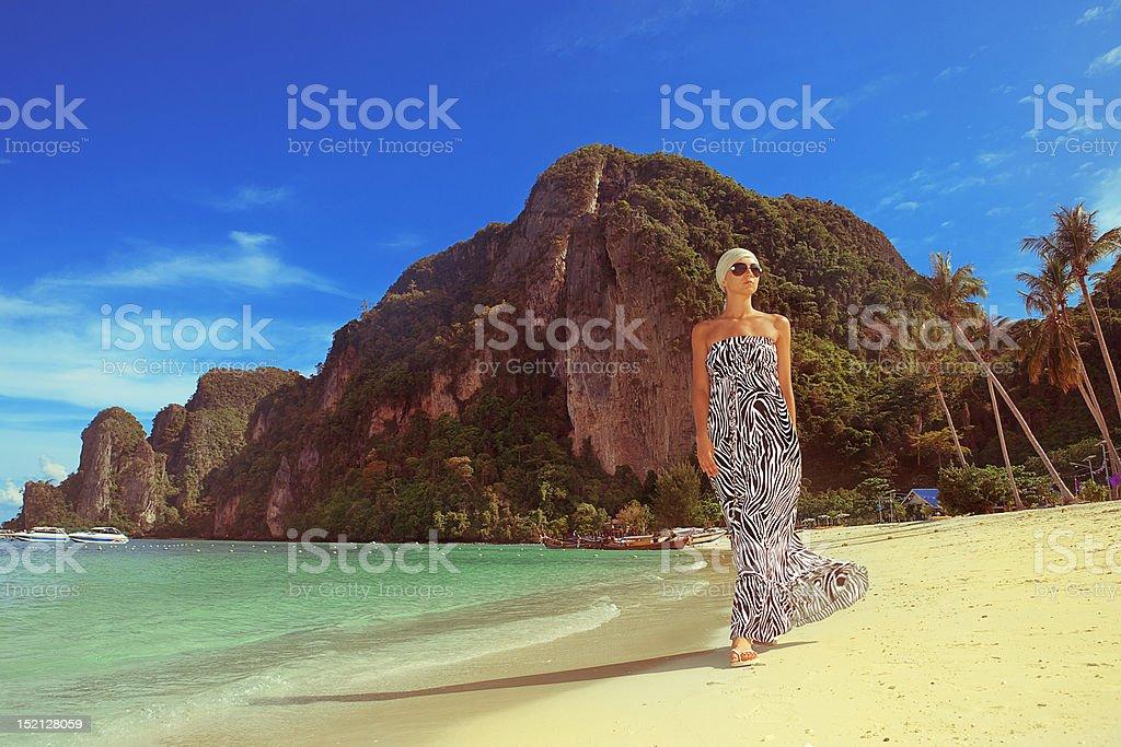 Woman on the beautiful beach royalty-free stock photo