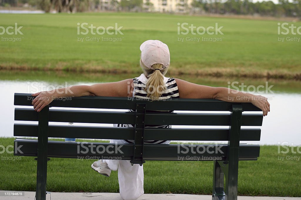 Woman on the bench royalty-free stock photo