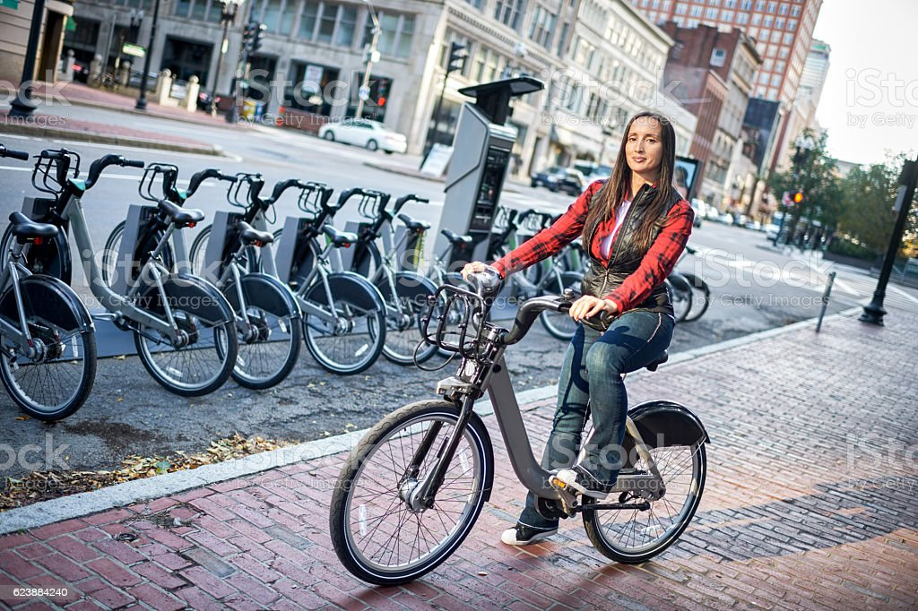 Woman on the bike in city stock photo
