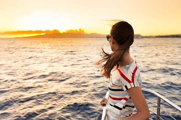woman on the cruise ship - veerboot stockfoto's en -beelden