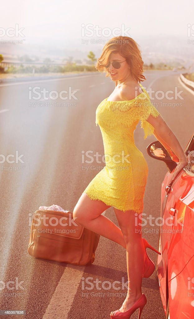 Woman on the highway with sparkles stock photo