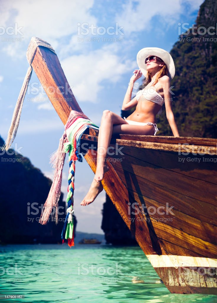 Woman on the longtail boat stock photo