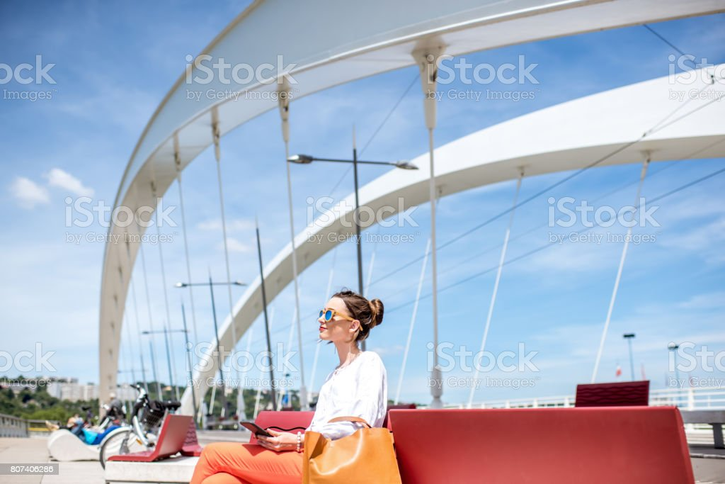Woman on the modern bridge in Lyon stock photo