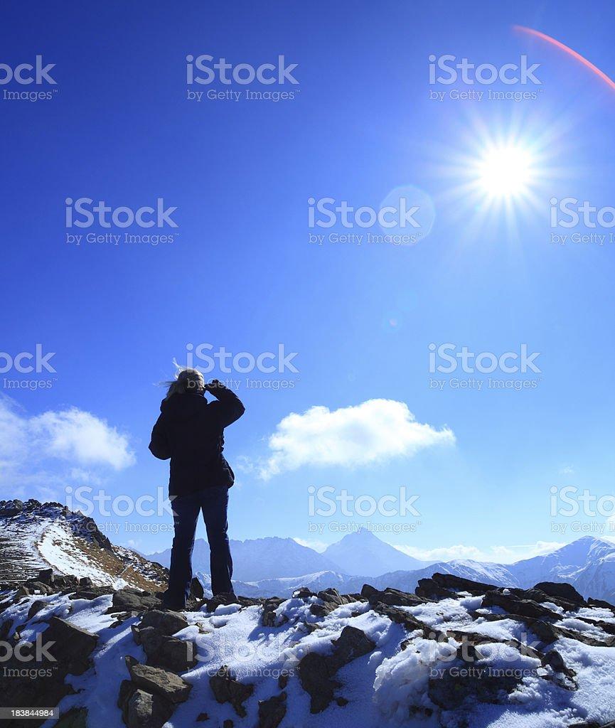 Woman on the mountain peak looking ahead royalty-free stock photo