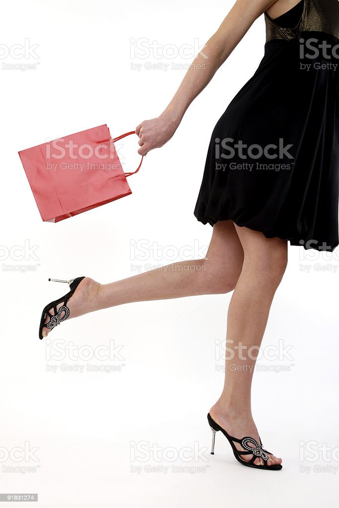 Woman on the move shopping stock photo
