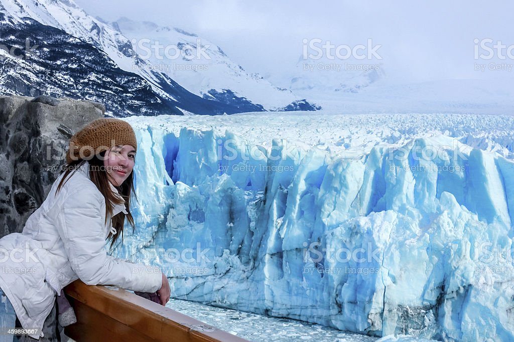 Woman on the Perito Moreno Glacier in Patagonia, Argentina stock photo