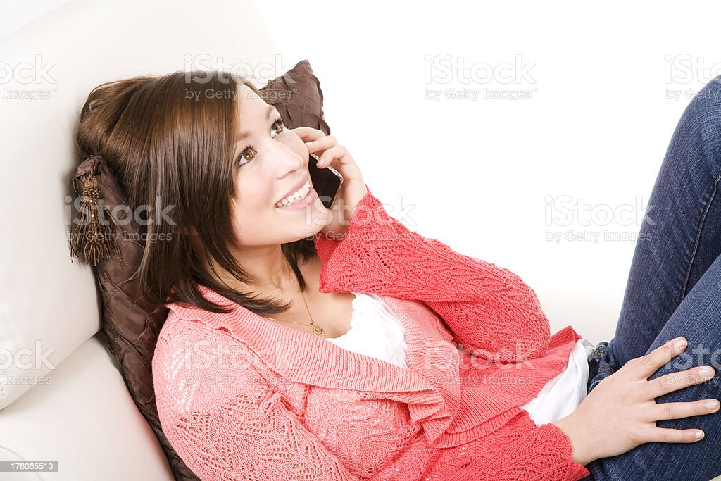 Woman on the phone at home smiling stock photo