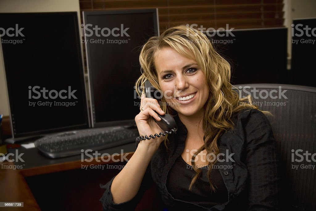 Woman on the phone at work stock photo