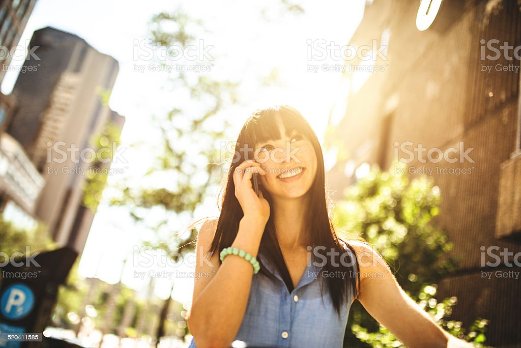 woman on the phone in Montreal stock photo