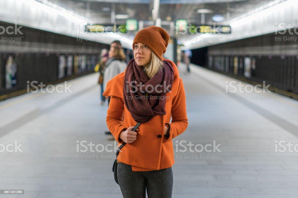 Woman on the railroad station platform stock photo