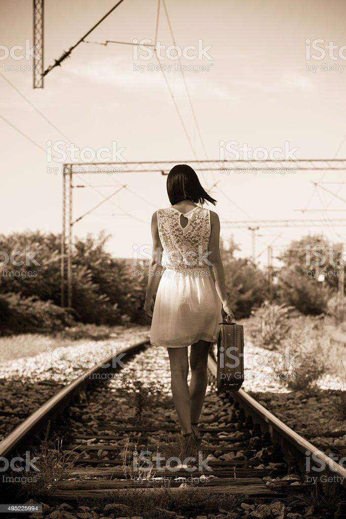 Woman on the railway stock photo