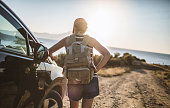 istock Woman on the road trip 1128162659