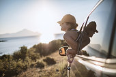 istock Woman on the road trip 1128162699