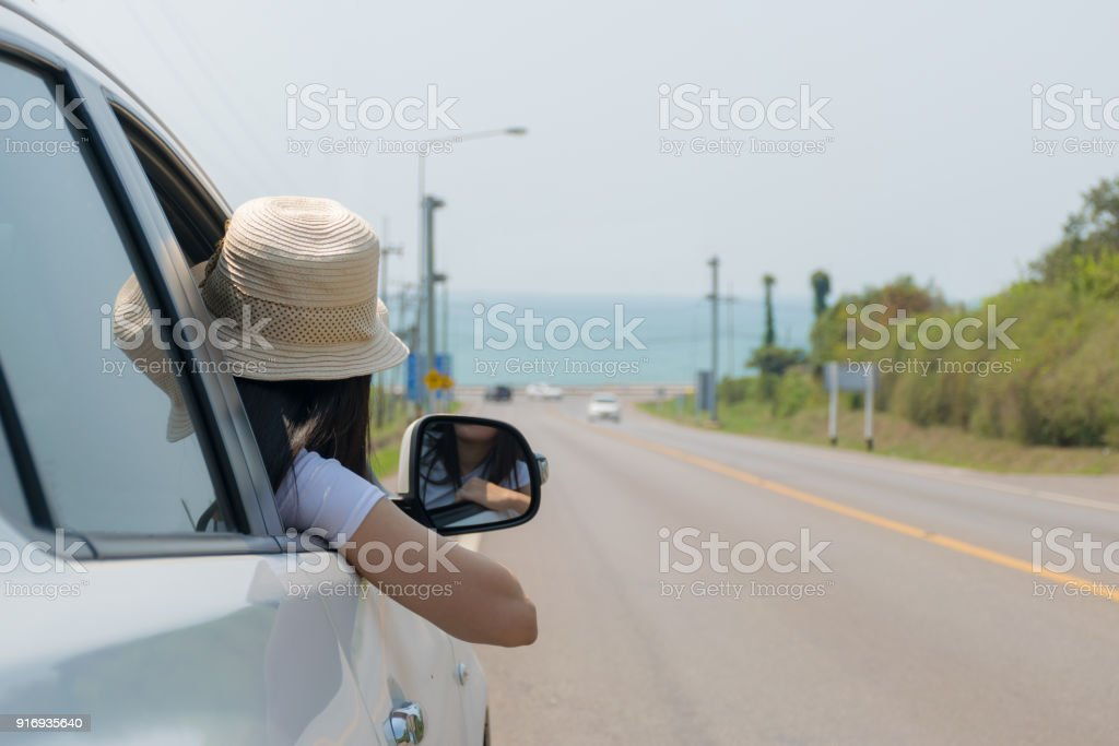 Woman on the road with a Sea and beach