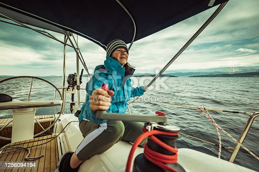 istock woman on the sailing yacht 1256094194