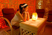 istock Woman on the salt therapy in the salt room 1308882275