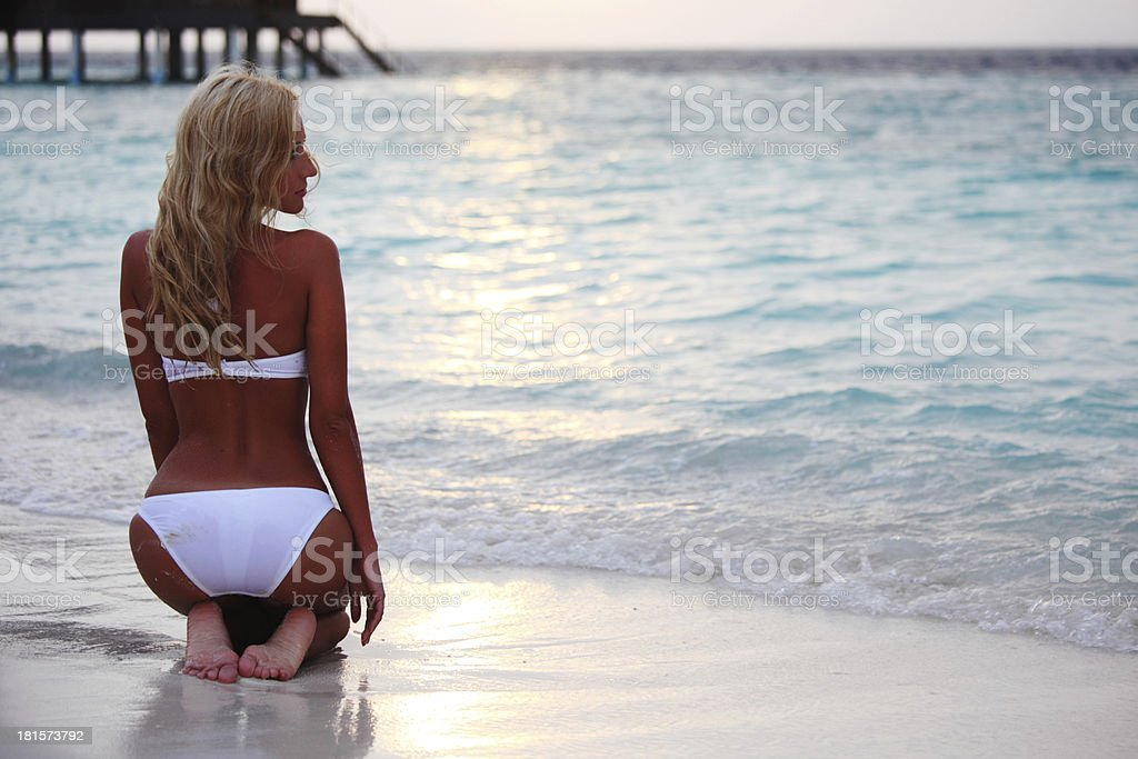 woman on the sand of ocean coast royalty-free stock photo