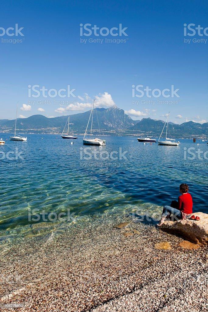 Woman on the shores of Lake Garda, Italy royalty-free stock photo