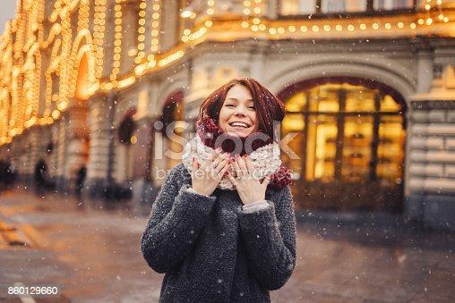 Woman wearing winter coat on the city street