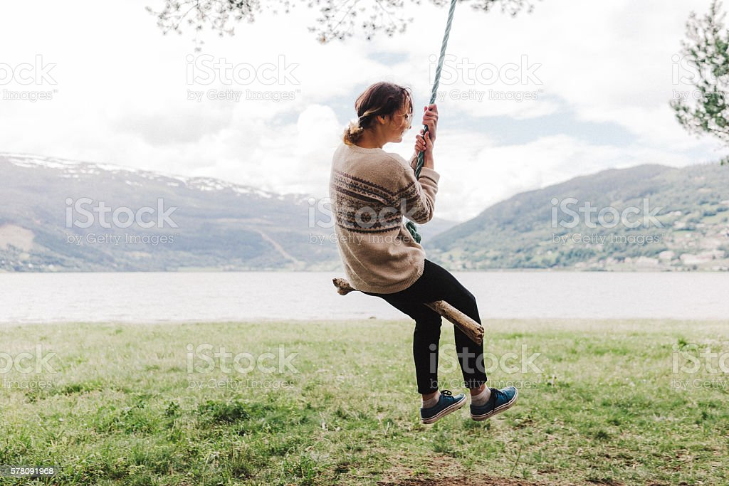 Woman on the swing stock photo