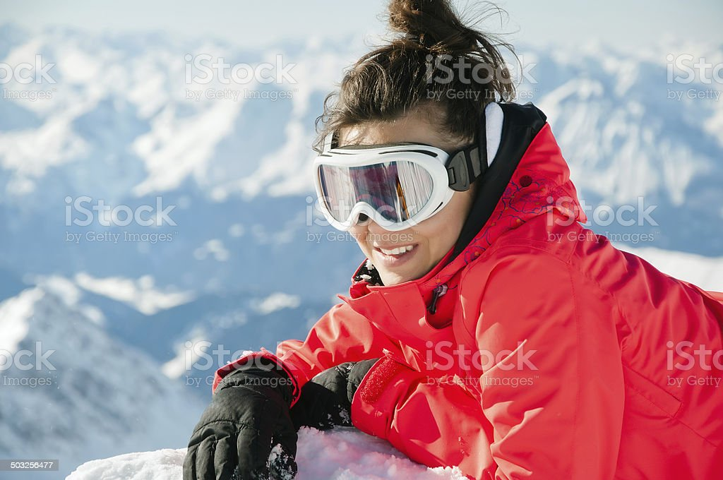 woman on the top of a high mountain stock photo