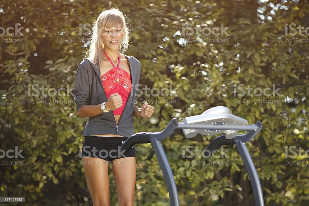 Woman on the treadmill royalty-free stock photo