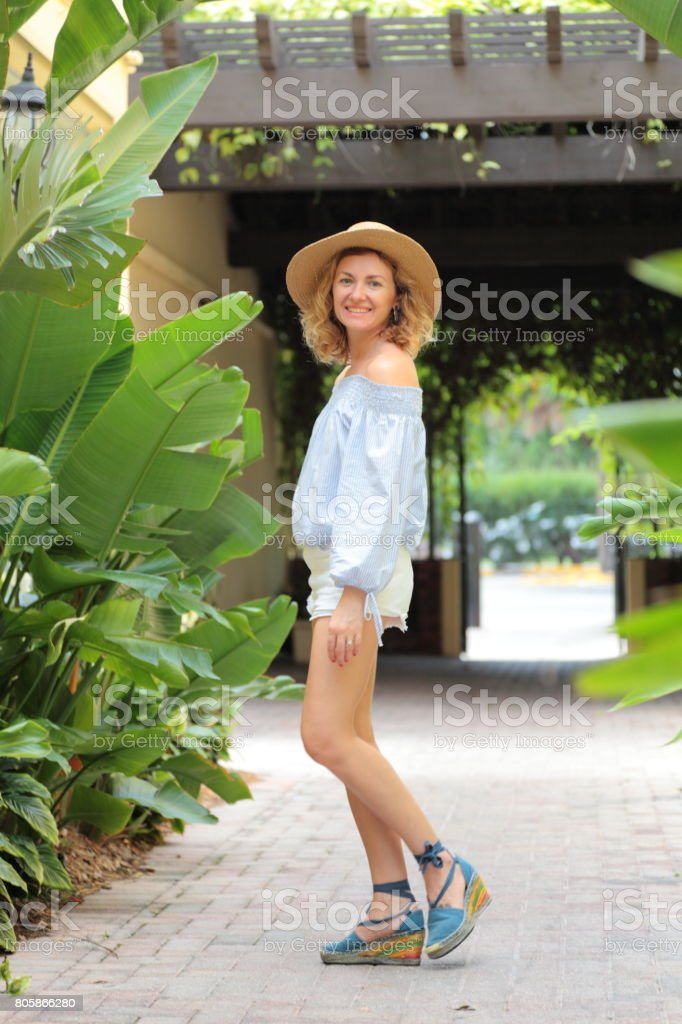 Woman on the tropical street. stock photo