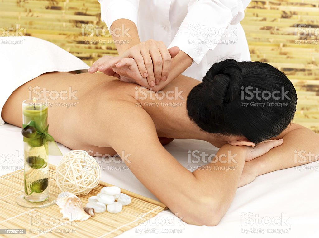 Woman on therapy massage of back in spa salon royalty-free stock photo