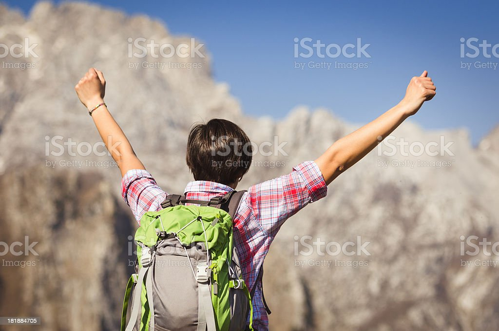 woman on top of the peak royalty-free stock photo
