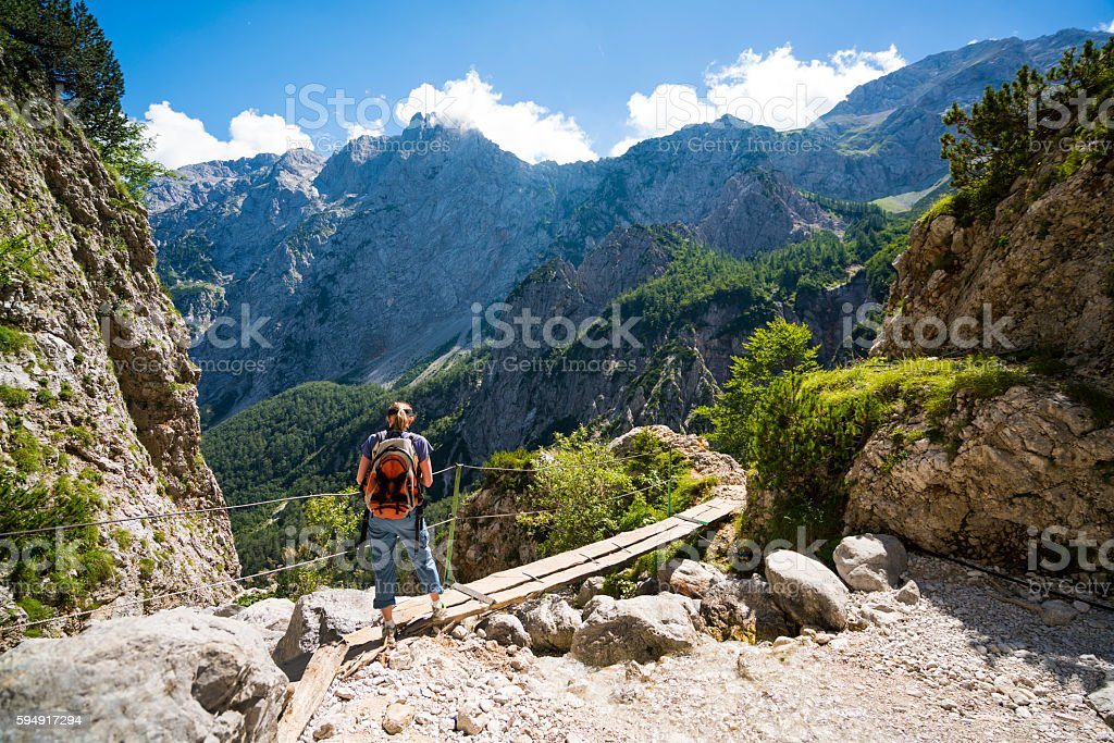 Woman on top of Waterfall Rinka in Logar Valley, Slovenia stock photo