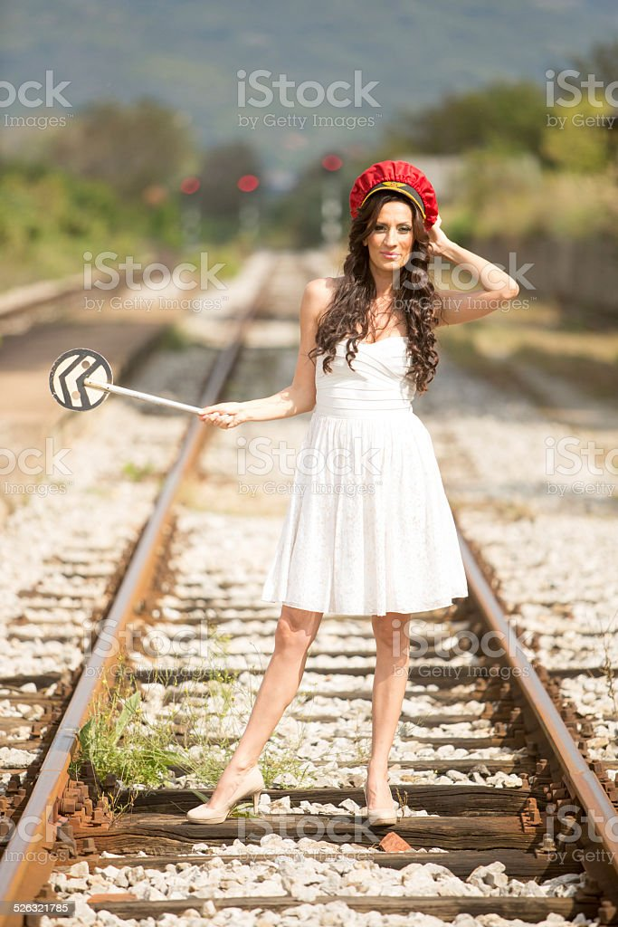 Woman on train track stock photo