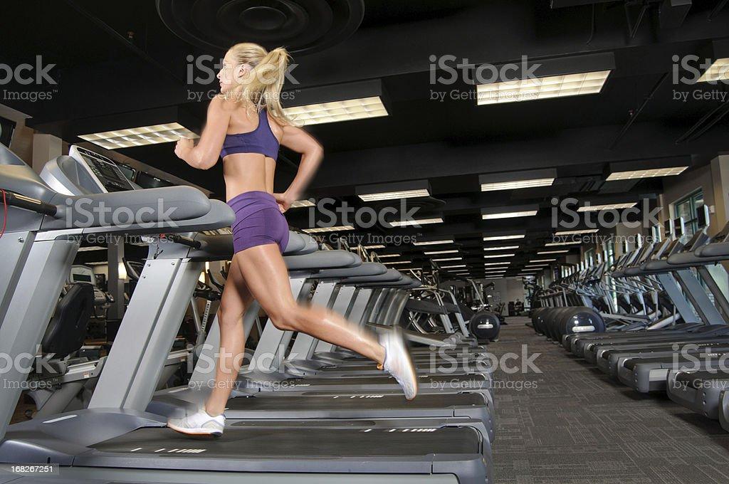 Woman on Treadmill stock photo