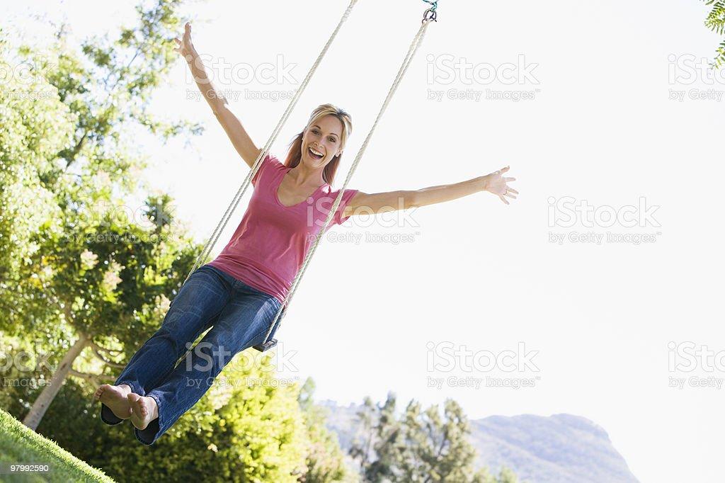 Woman on tree swing royalty-free stock photo