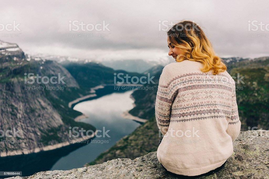 Woman on Trolltunga stock photo