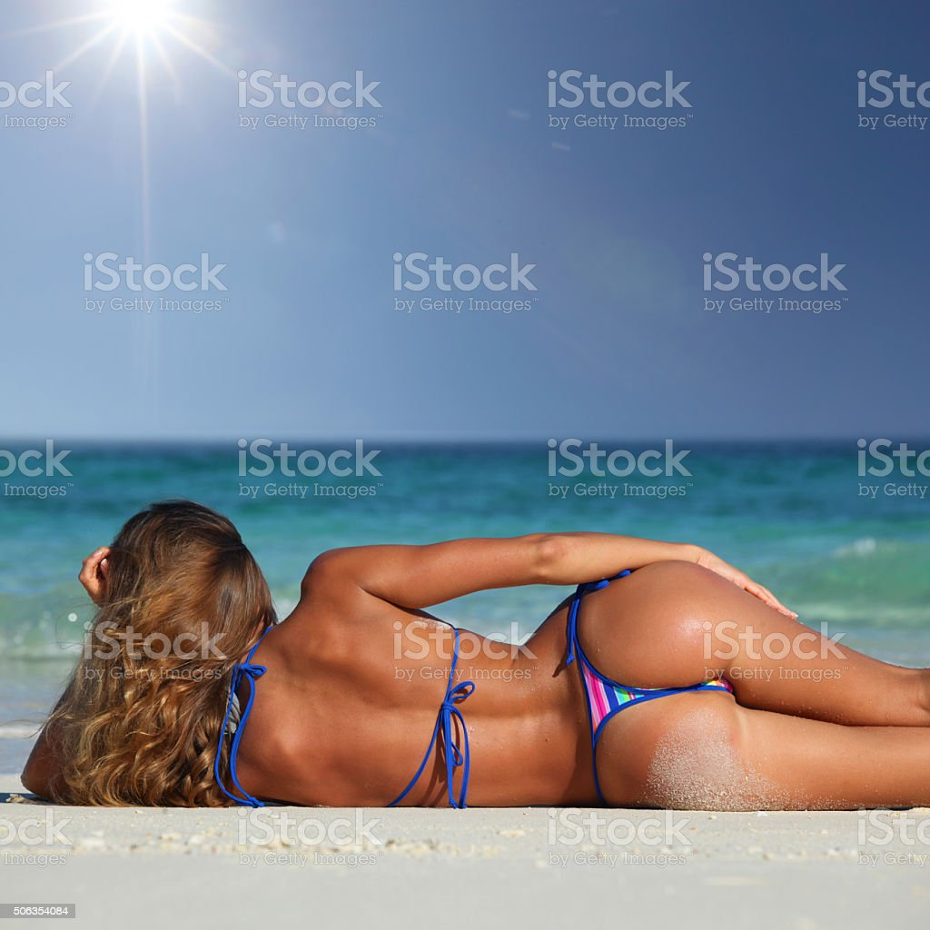 Woman on tropical beach stock photo