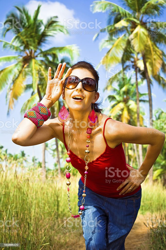 Woman on tropical vacation Happy woman enjoying  tropical vacation. Coconut palm trees in the background. 30-34 Years Stock Photo