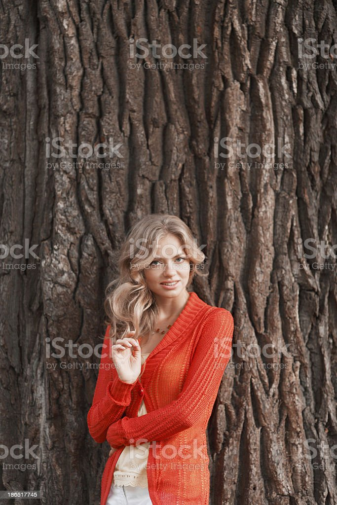 Woman on trunk background royalty-free stock photo
