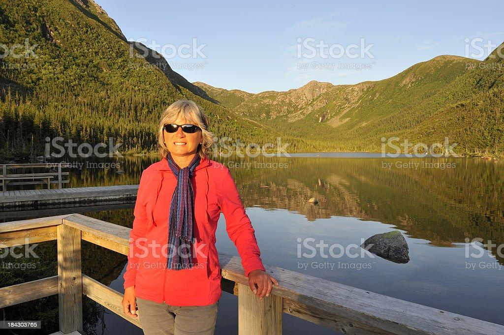 Woman on vacation at lake stock photo